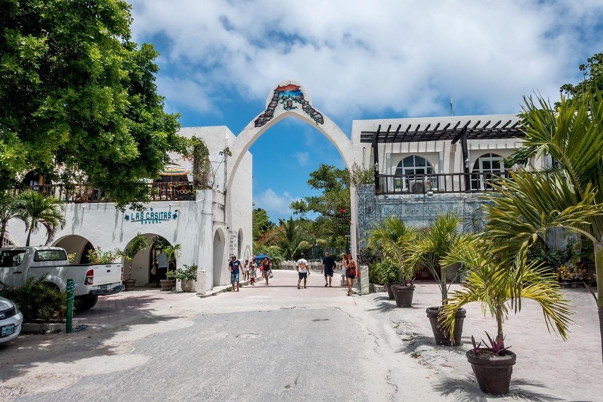 People walking through the main entrance gate to Akumal, Mexico