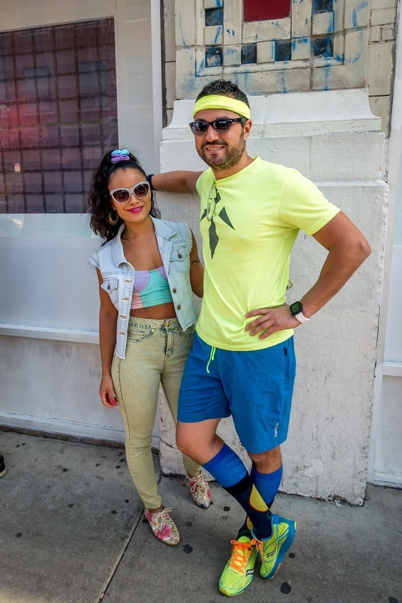 Visitors in 90s style neon costumes