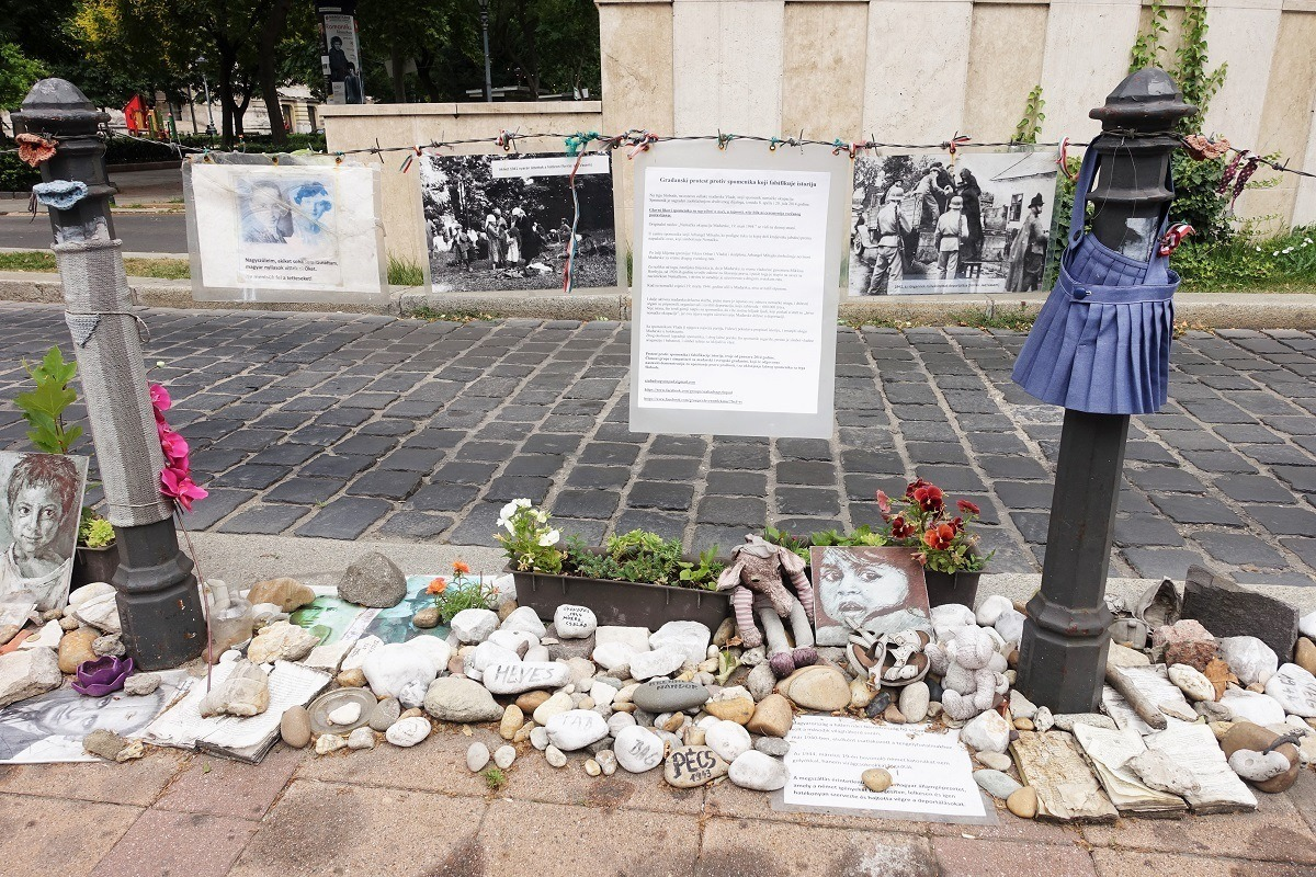 Memorial stones and tributes in a city square