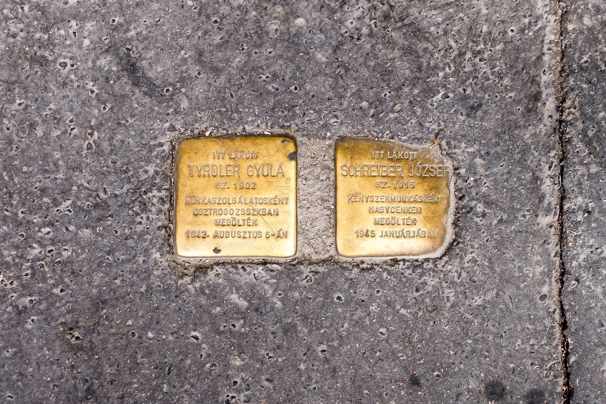 Gold memorial plaques with names and dates inscribed