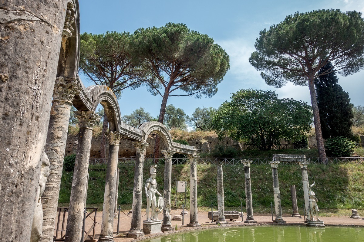 Statue and arches by the Canopus pool of Hadrian's Villa in Tivoli Italy