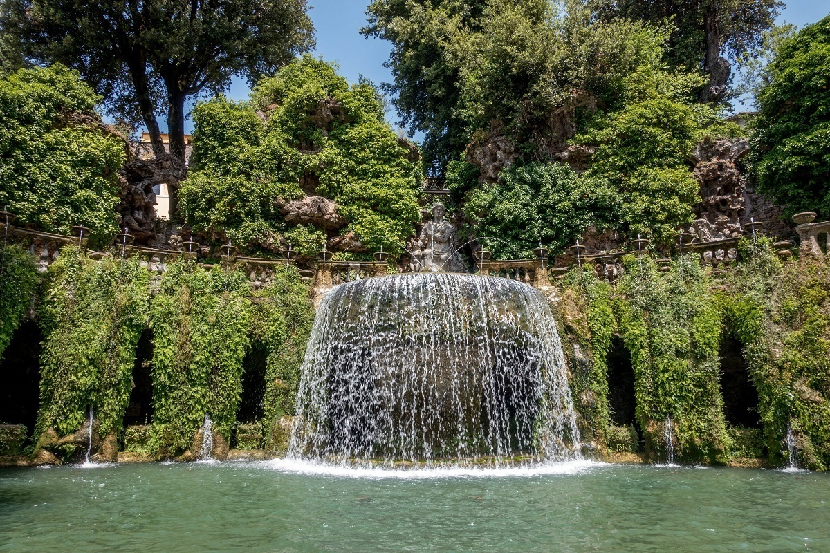The Fountain of Tivoli is a wall of water topped with a statue among greenery