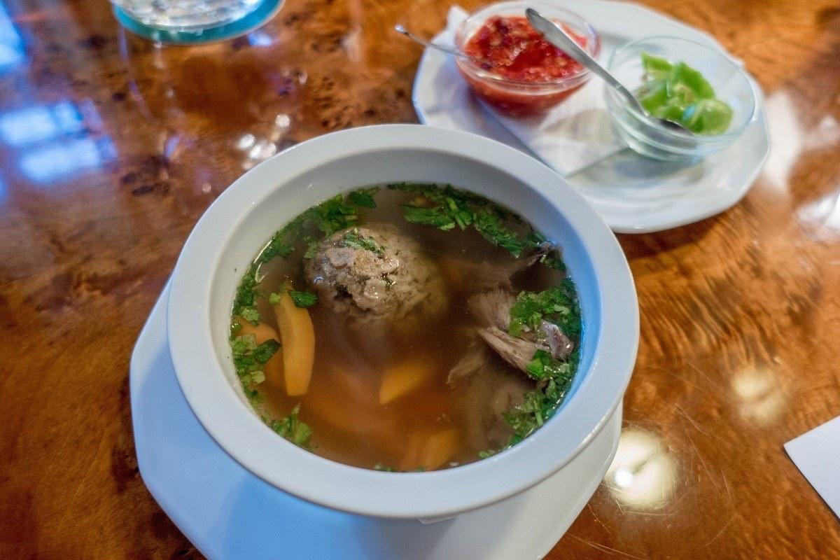 Goose matzo ball soup in a bowl