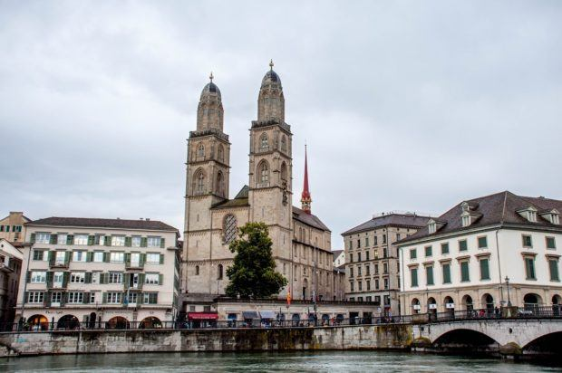 Buildings and a church beside a river