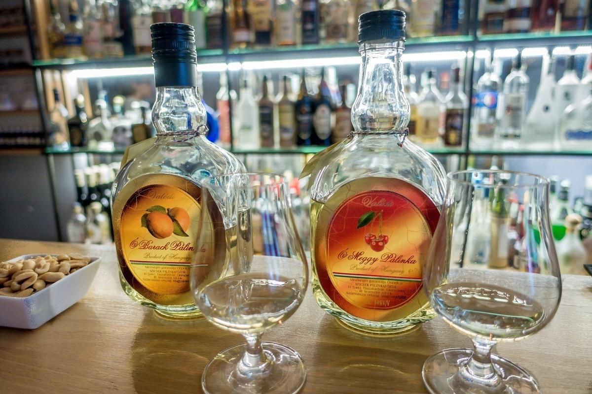 Bottles and glasses of palinka, Hungarian fruit brandy