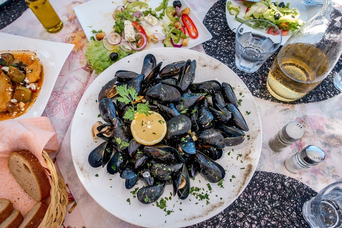 Mussels, salad, and other food on a table