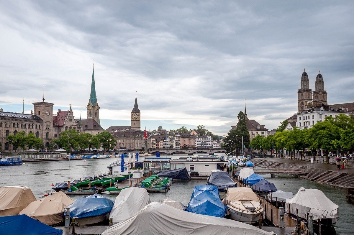 Covered boats with skyline views of the Zurich old town from the Quaibrucke