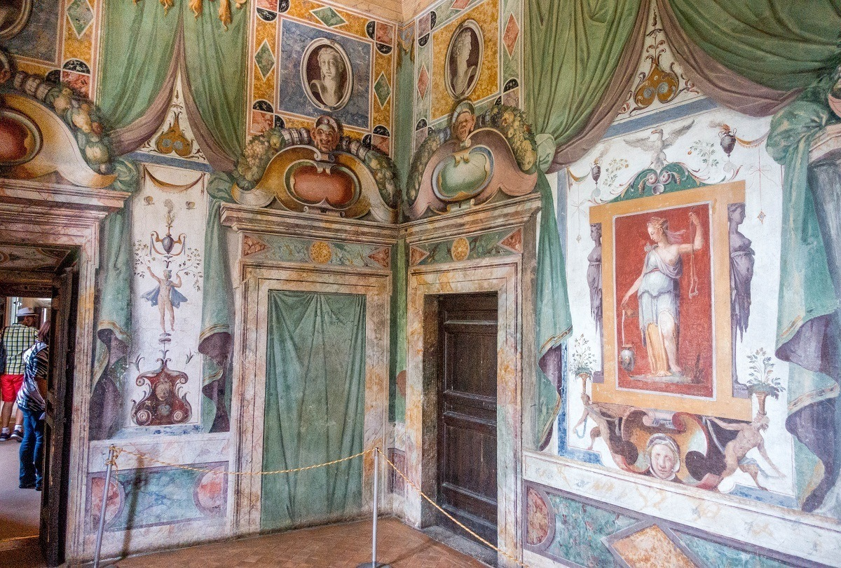 Painted walls showing a woman in a toga and other decorations