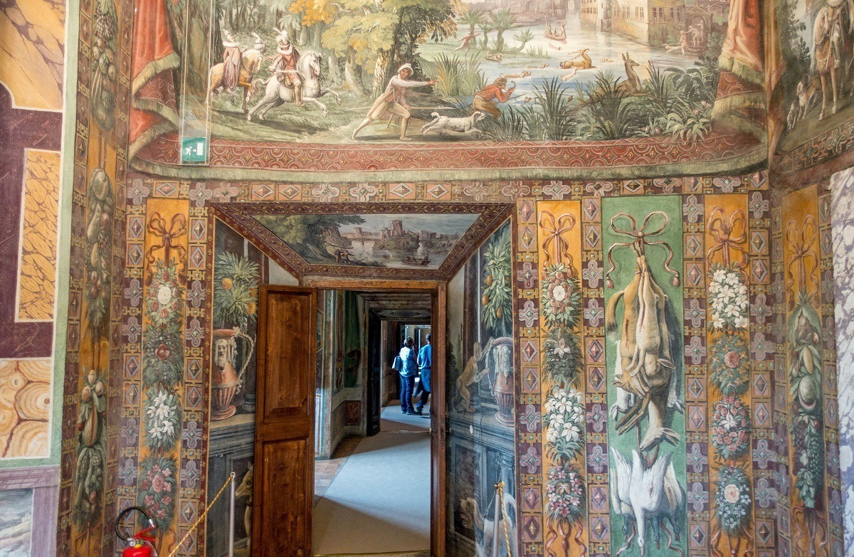 Brightly painted walls with animals and hunting scenes