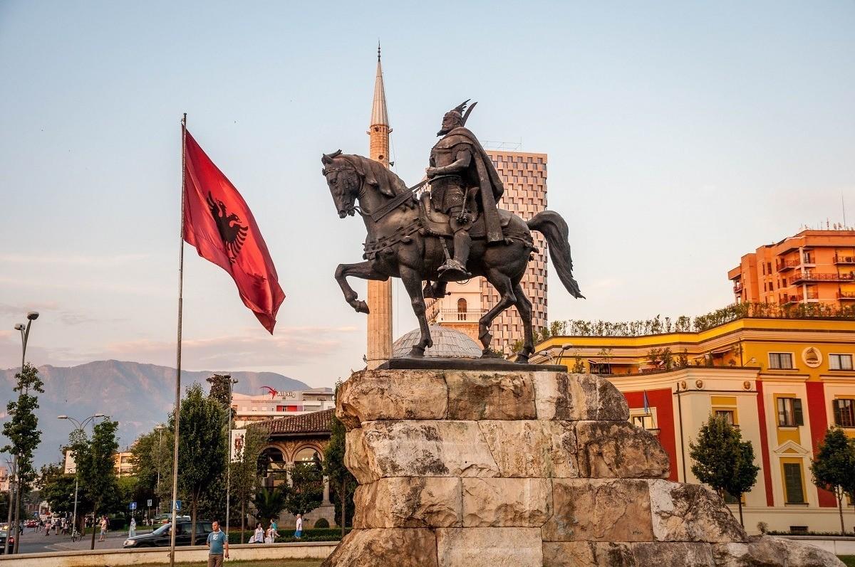 Skanderbeg statue and Albanian flag in Tirana
