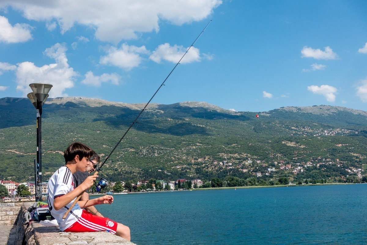 People fishing from the promenade in Ohrid