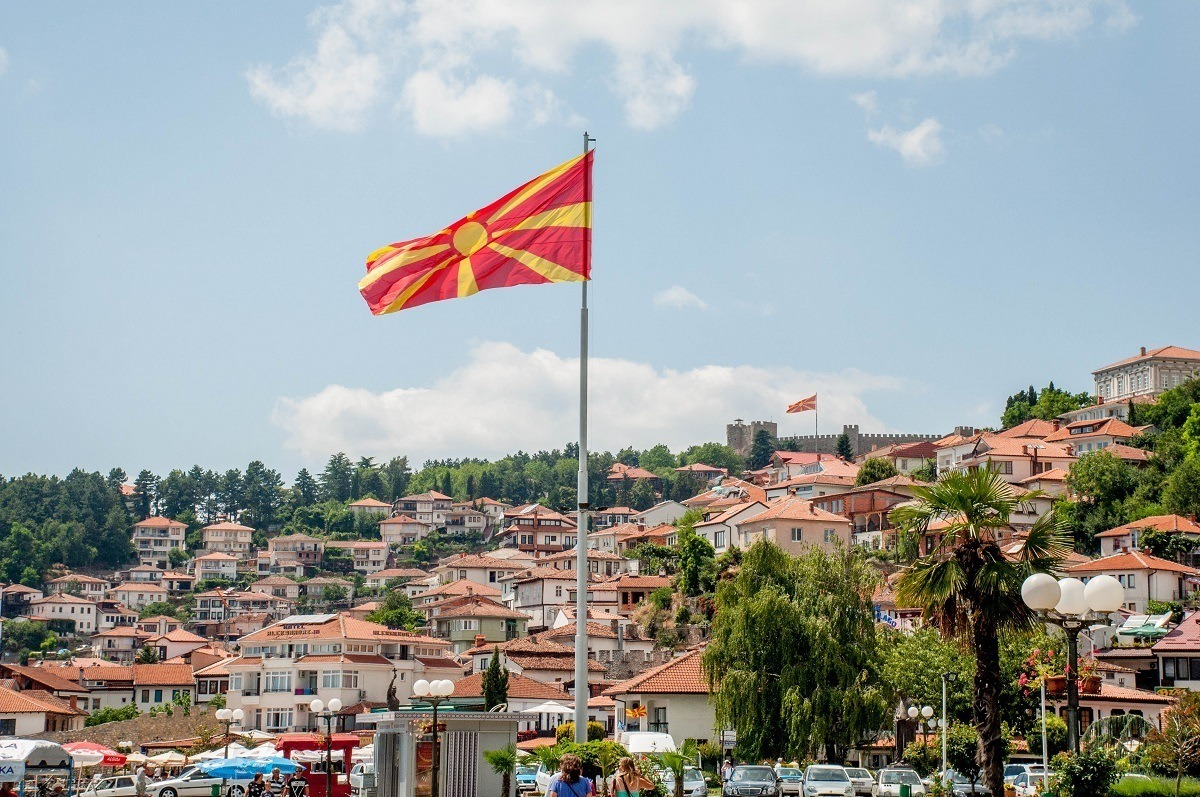 The town of Lake Ohrid and the North Macedonian flag