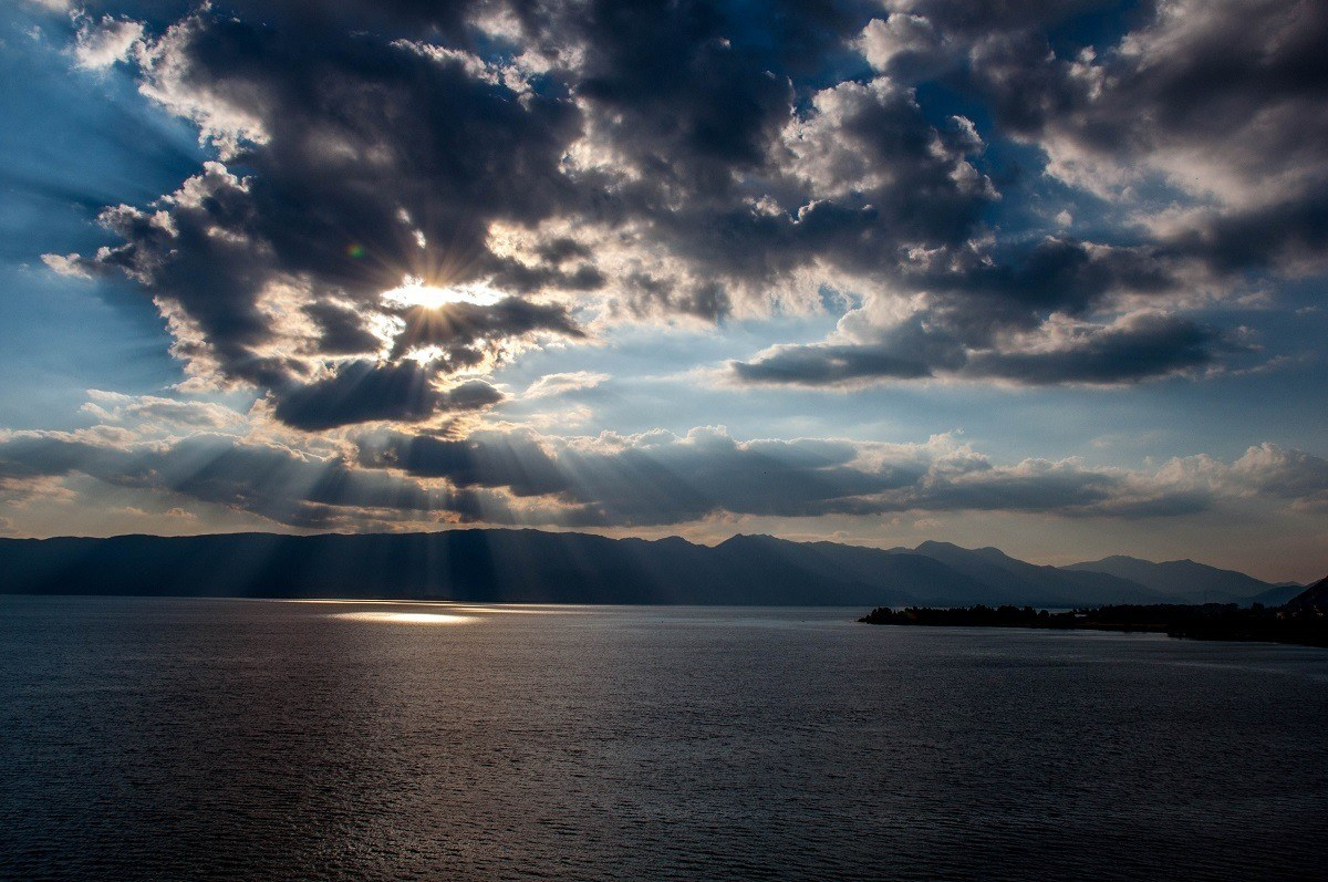 Sun rays peaking through the clouds at Lake Ohrid in North Macedonia