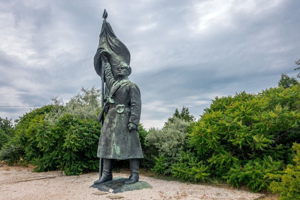 Sculpture of Soviet soldier standing with a flag