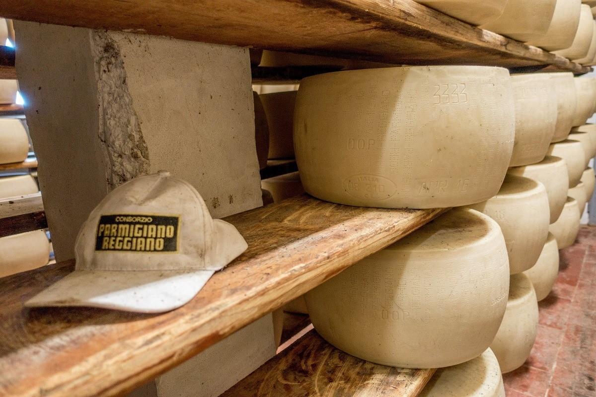 Wheels of Parmigiano-Reggiano aging on shelves