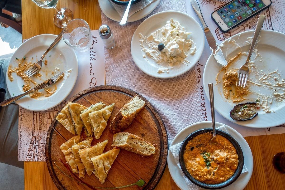 Tarator, burek, and other Albanian food on a table