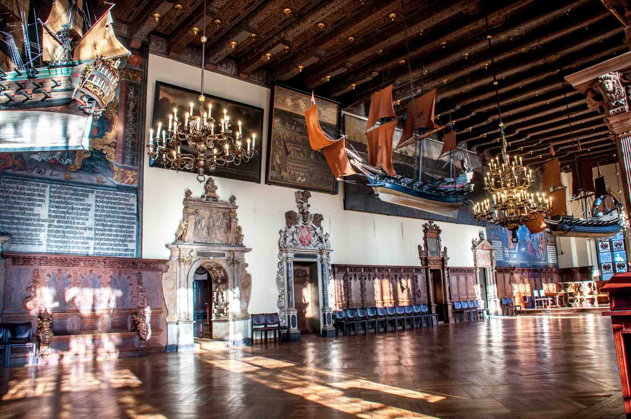Upper Hall with paintings and replica ships hanging from the ceiling