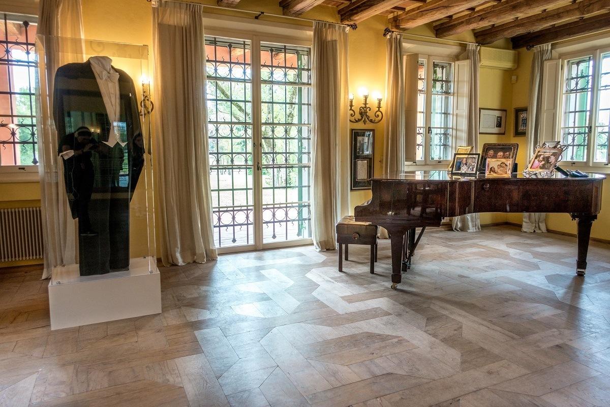 Piano, tuxedo, and memorabilia on display
