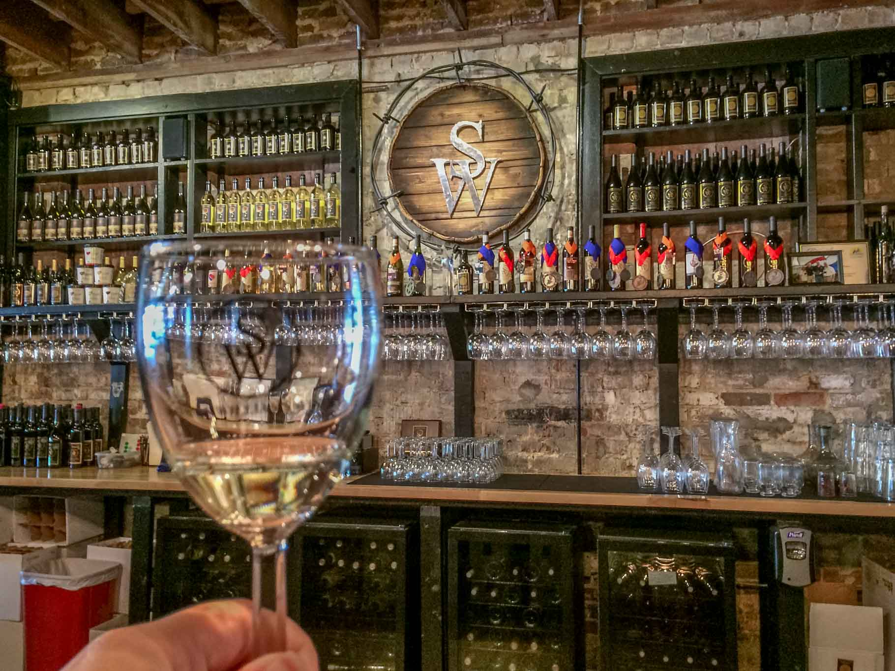 Wine glass and bar at Sloan & Williams Winery in Grapevine, Texas