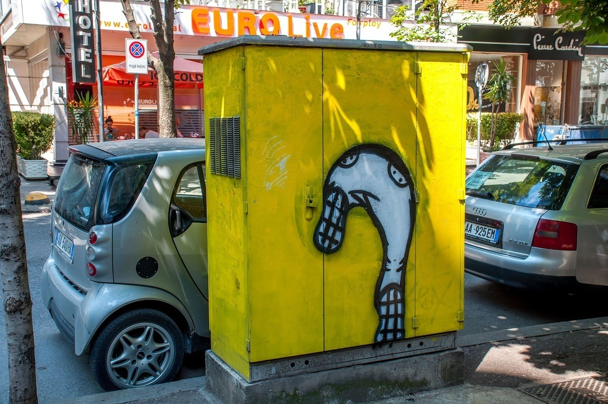A cartoon on the electrical box in the Block