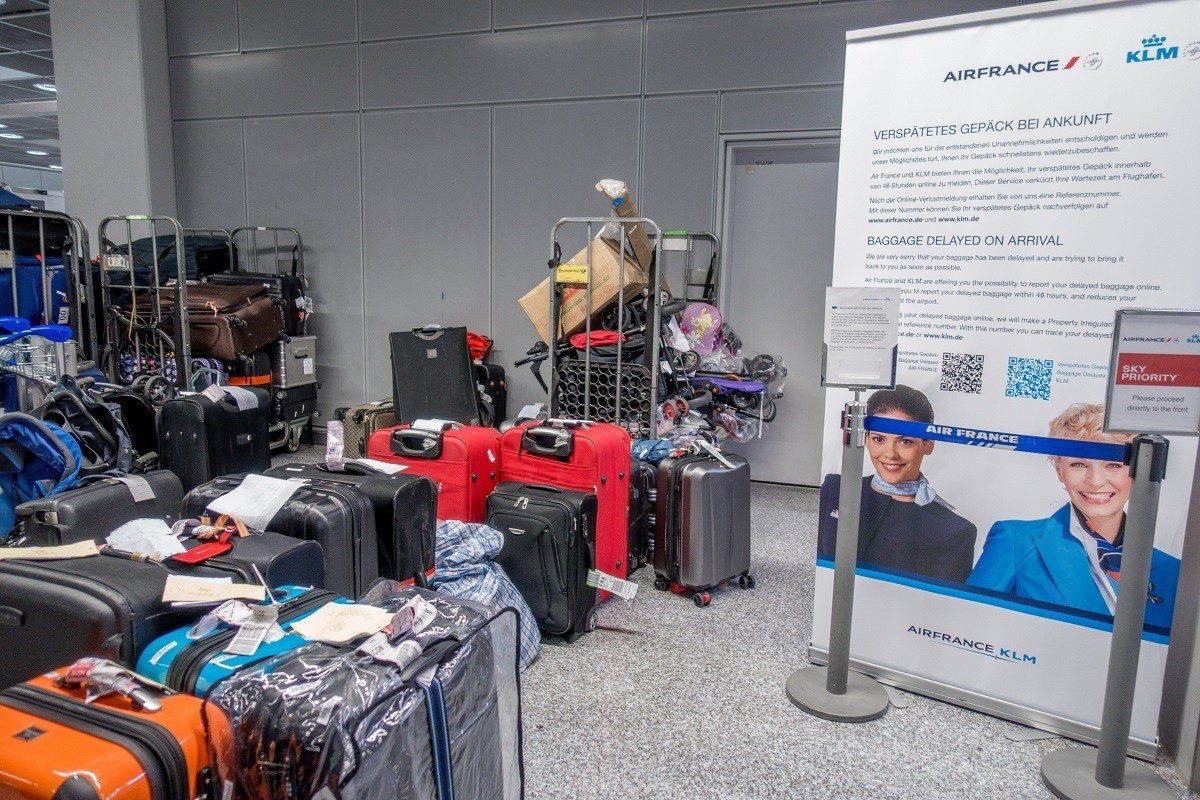 Piles of suitcases in the airline lost luggage area at the airport