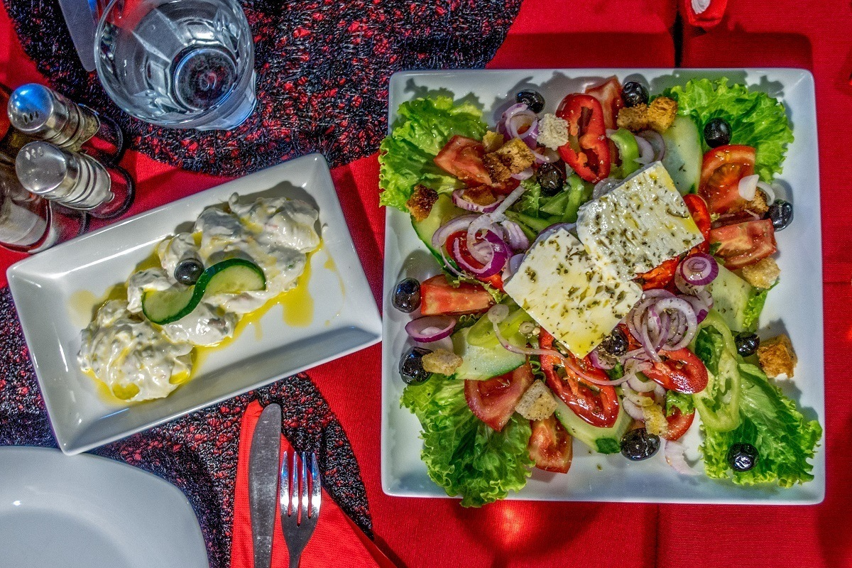 Vegetable salad and garlic yogurt dip called tarator on a table