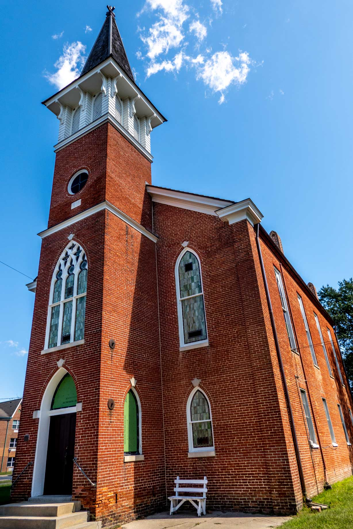 Red brick church with stained glass windows