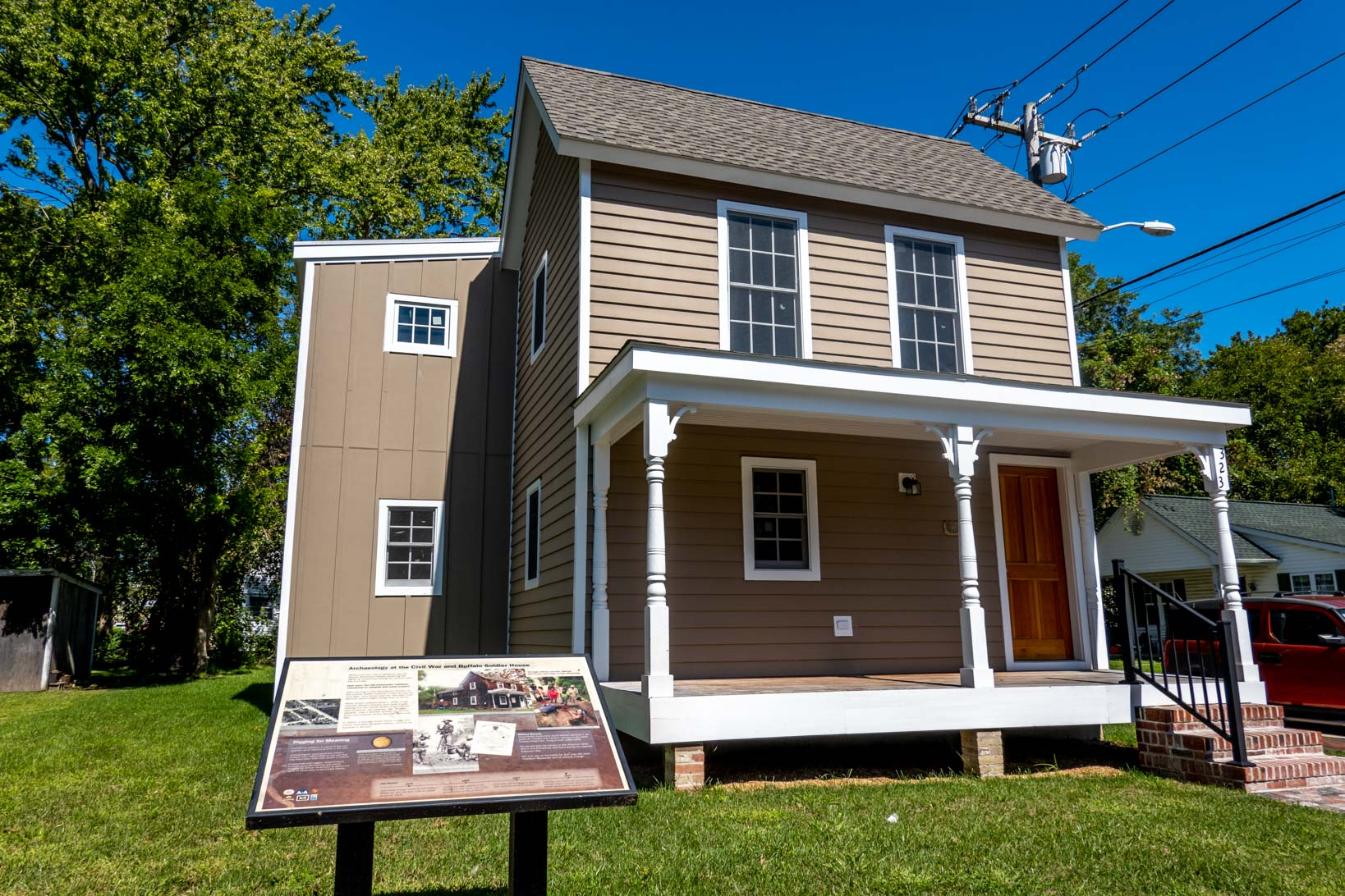 Brown house with information panel in front