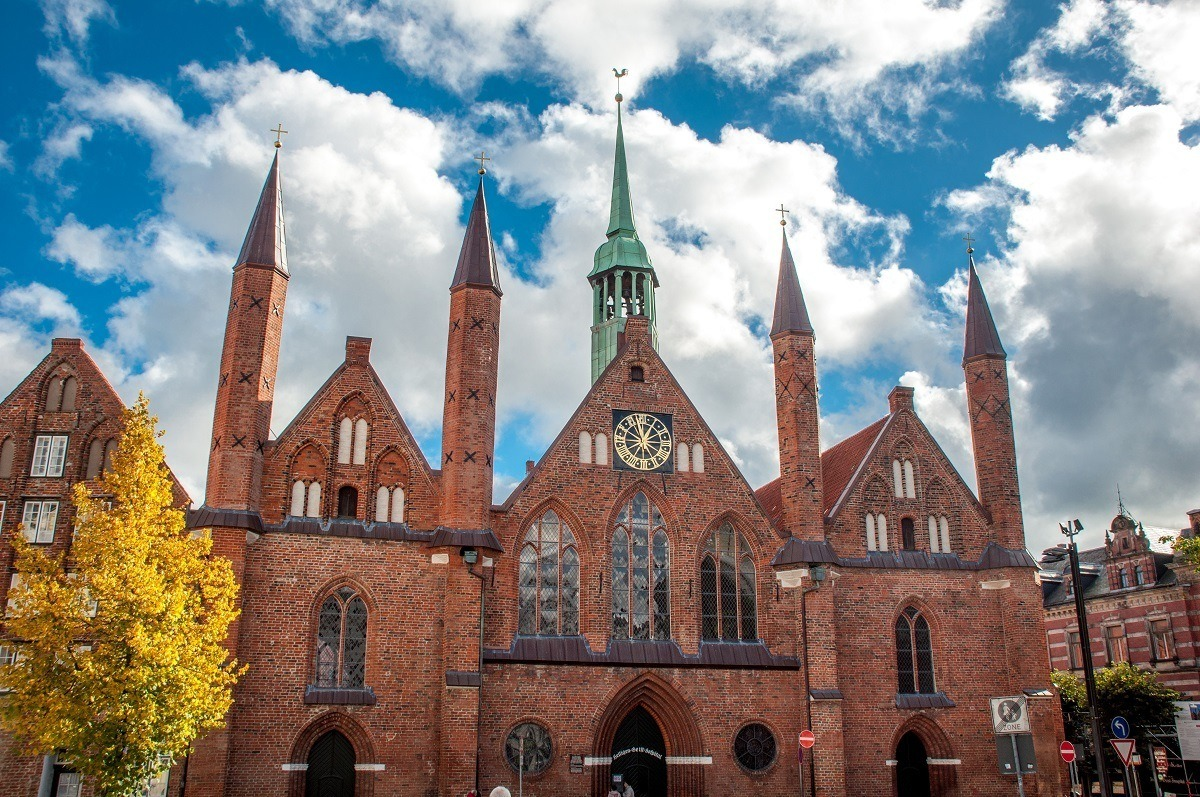 Medieval building with spires and clock, Lubeck's Hospital of the Holy Spirit