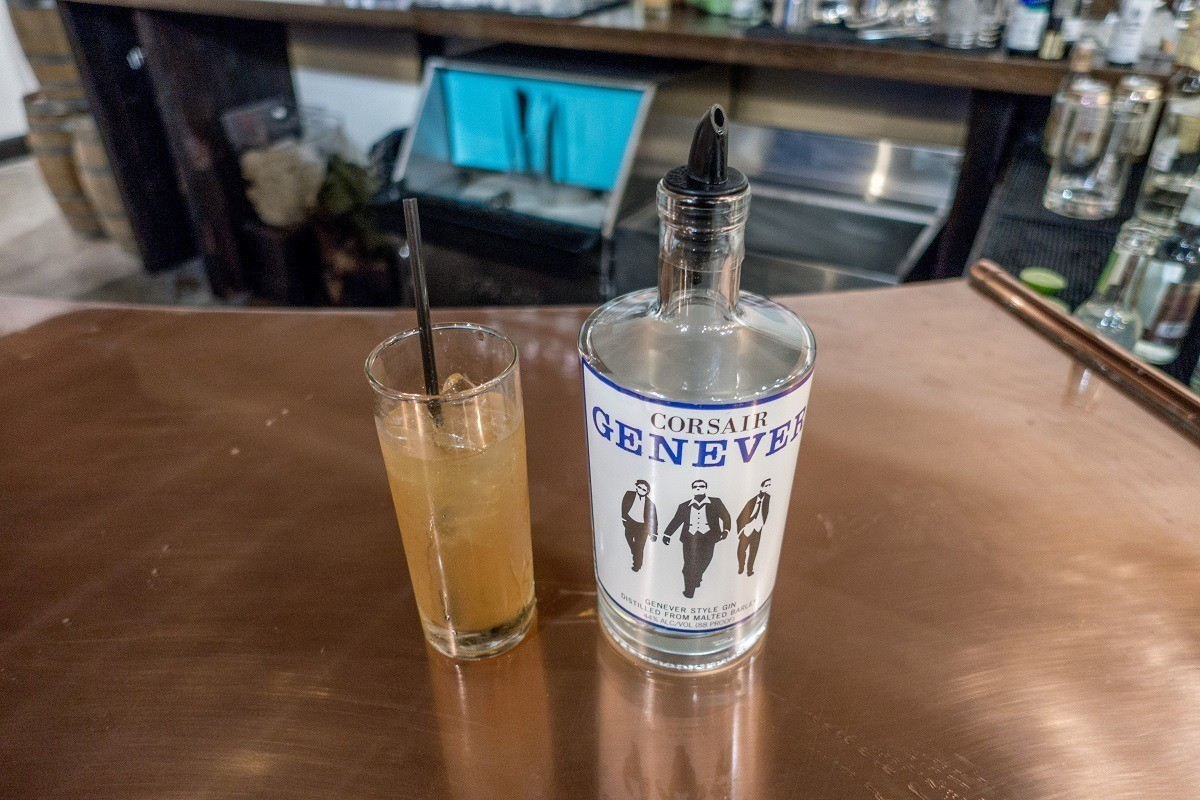 Genever bottle and cocktail on a counter at Corsair Distillery in Nashville