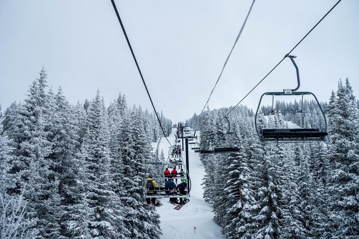 People on a ski lift in the winter at Ski Santa Fe