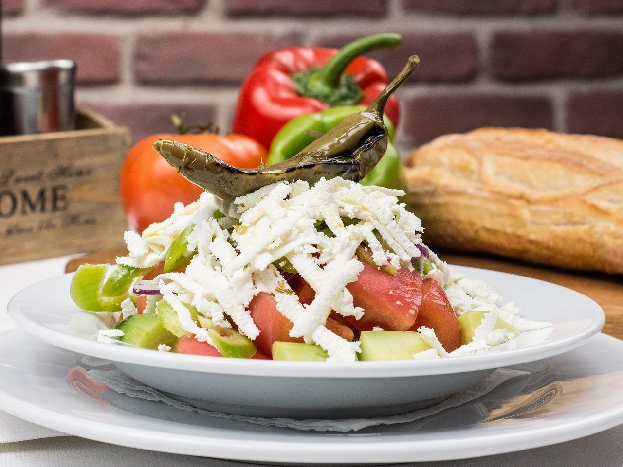 Salad of tomato, cucumber, and shredded cheese