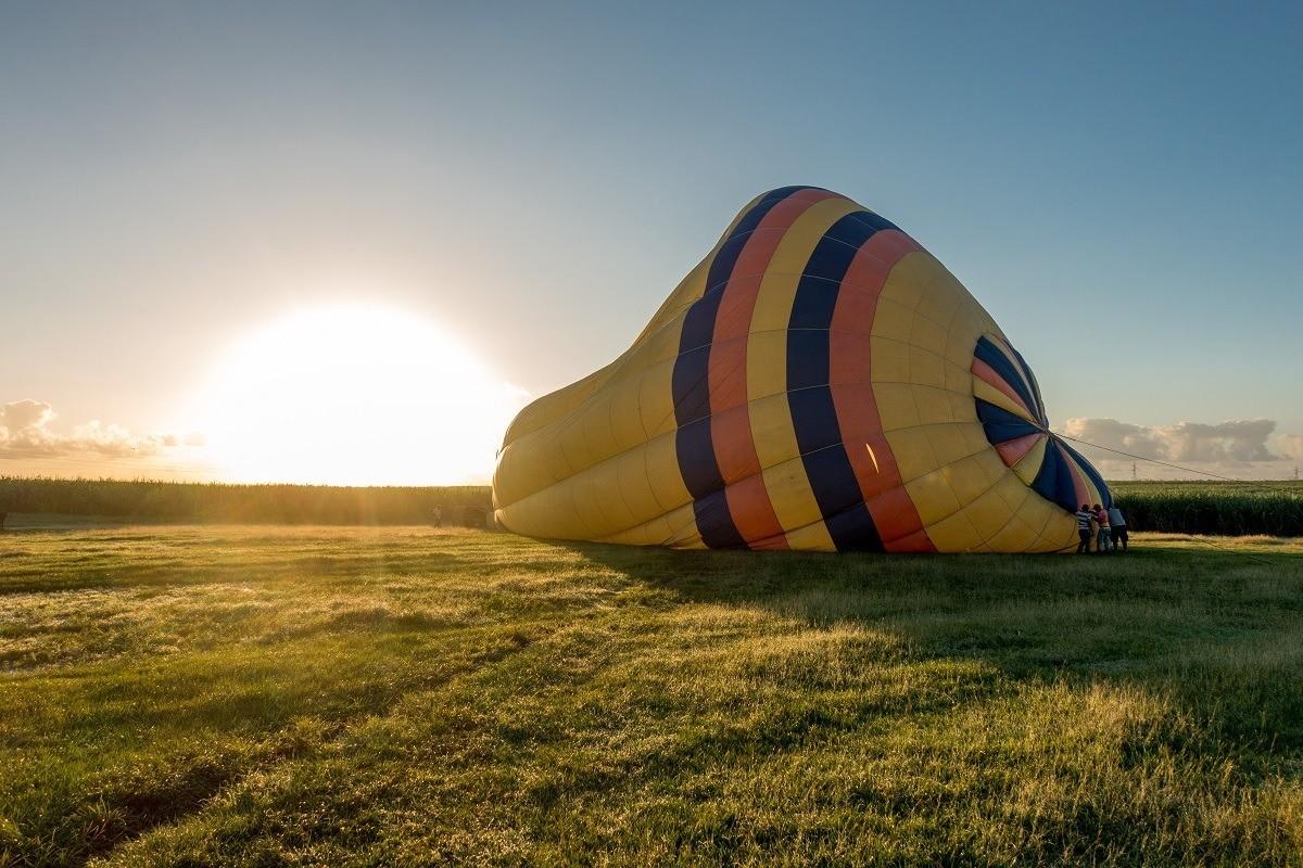 Inflating a hot air balloon at sunrise