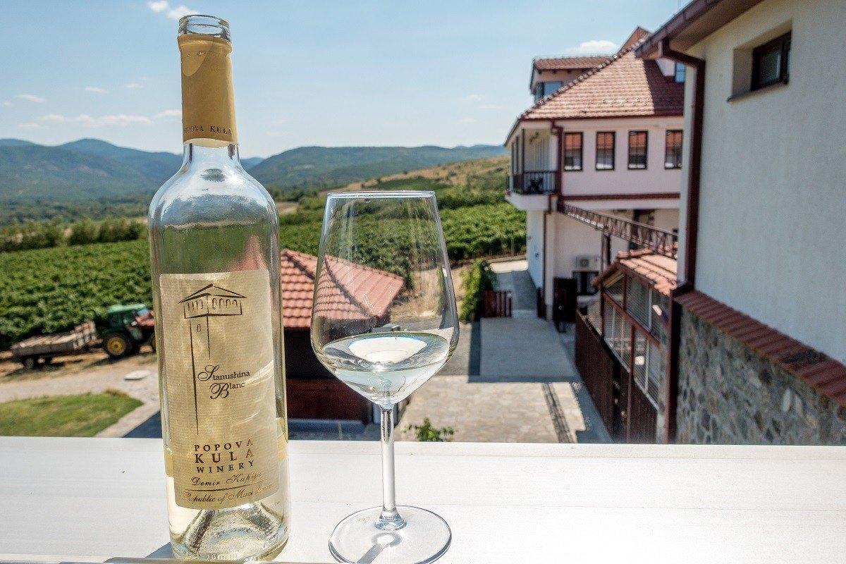 Wine bottle and glass at Popova Kula winery
