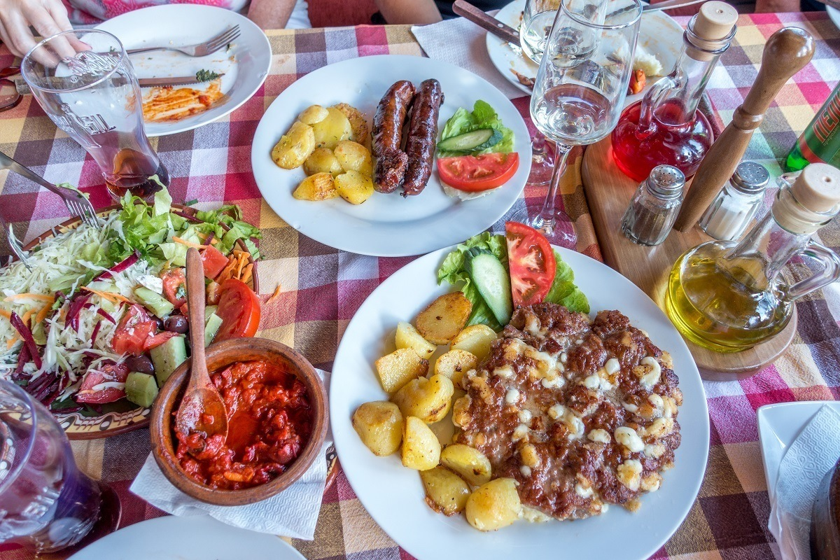 Salad, potatoes, sausages, and traditional food