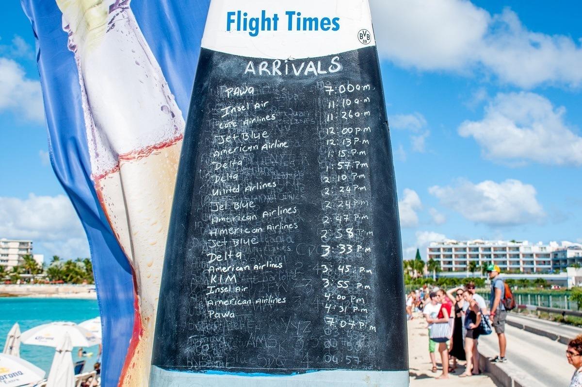 Schedule of planes landing written on a surfboard