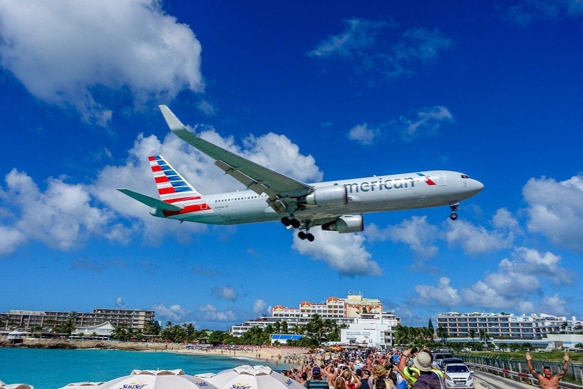 Jet landing over Maho Beach at Princess Juliana International Airport in Saint Martin.