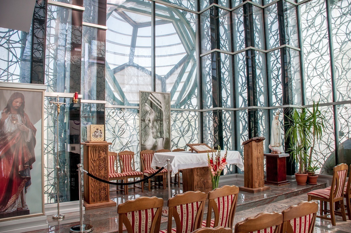 Chairs and altar in a chapel with glass walls