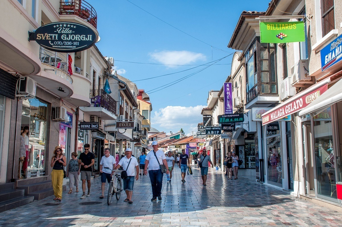 People walking down a street full of shops in Old Town Ohrid