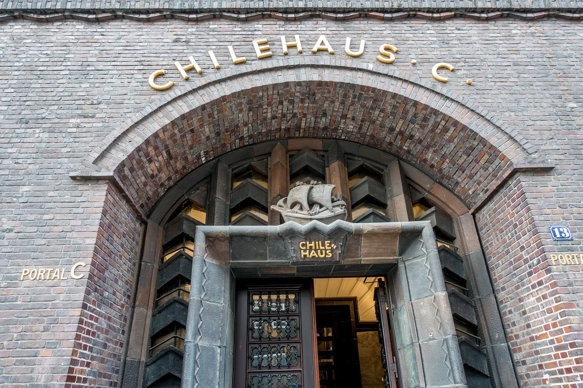 Exterior of brick building with a boat over the door, The Chilehaus