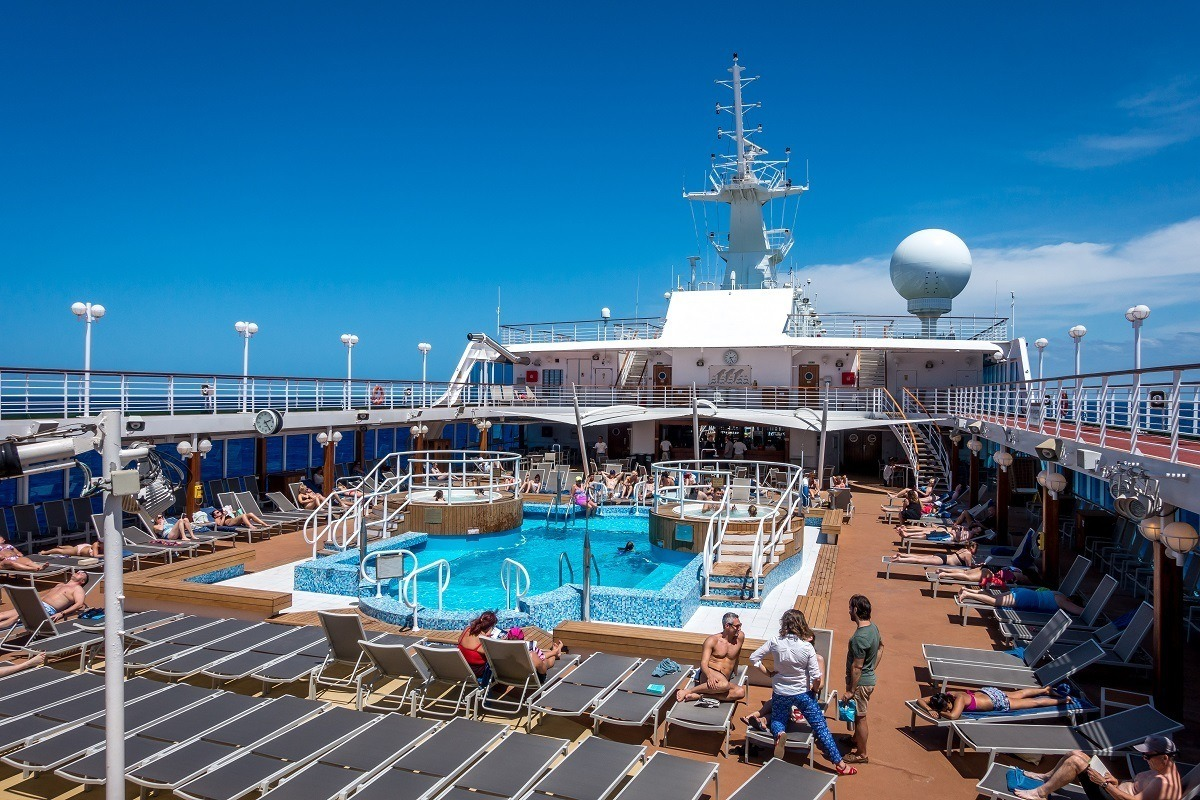 Lounge chairs by the swimming pool on a cruise ship
