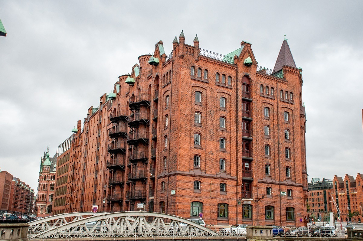 Red brick warehouses connected by a bridge