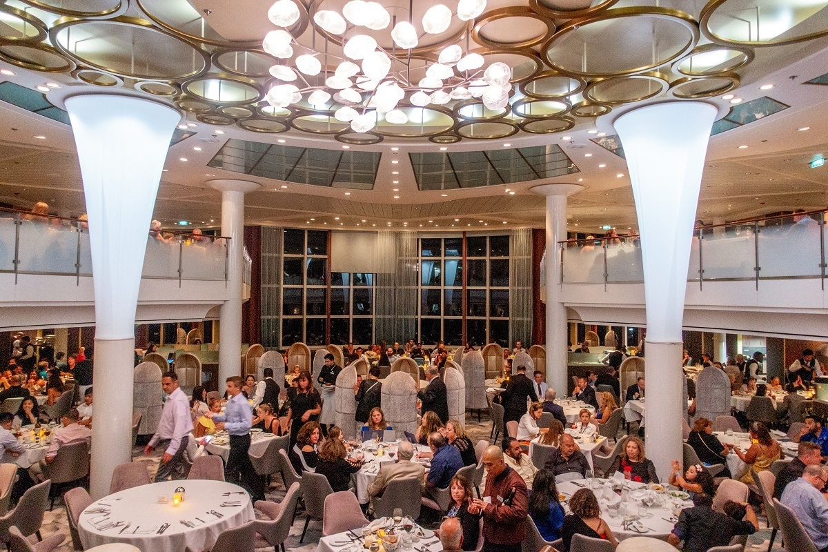 Main dining room full of people on cruise