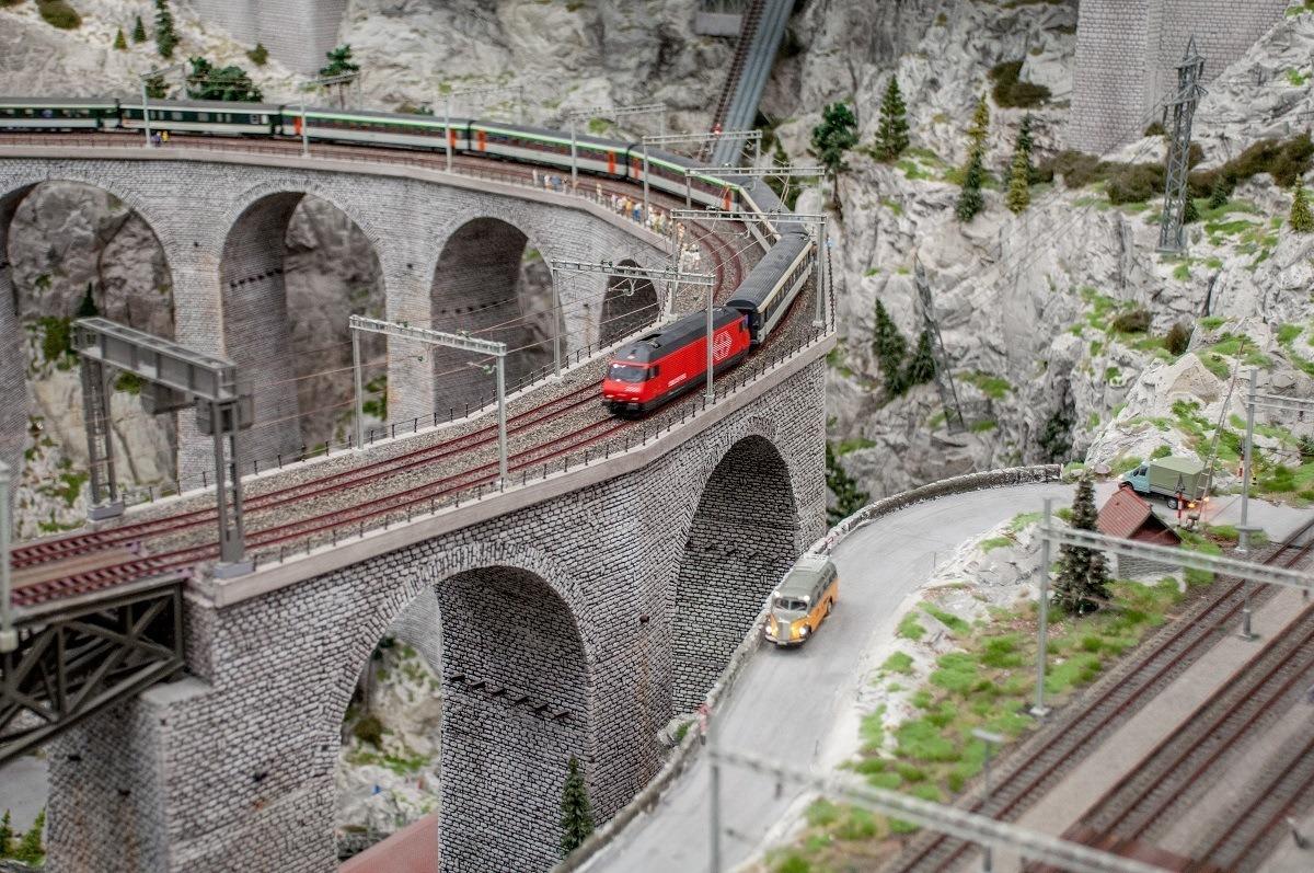 Model railroad train crossing bridge on the largest model train set in the world