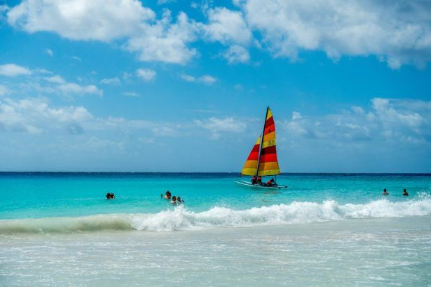 Windsurfer and swimmers in the ocean