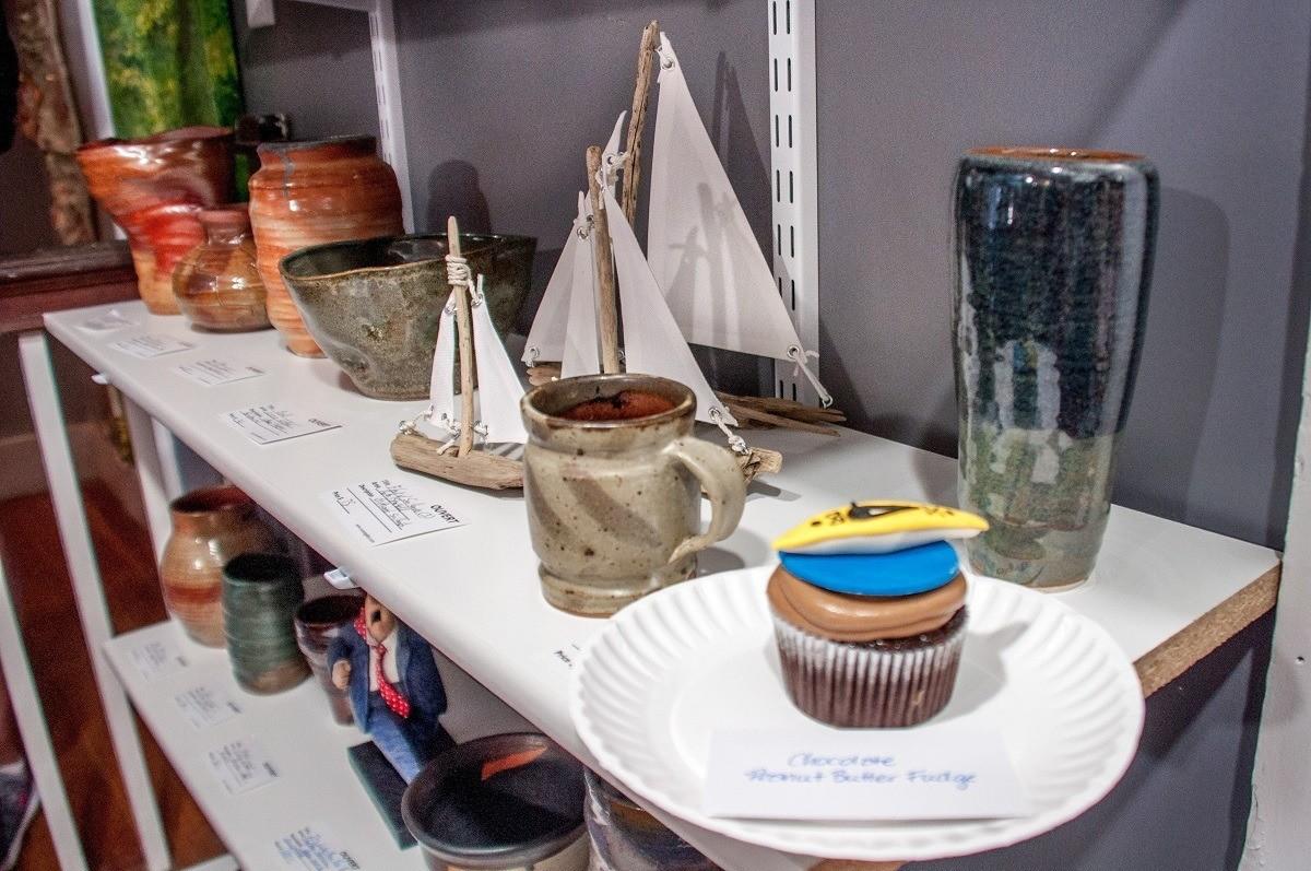 Cupcake on a shelf in an art gallery