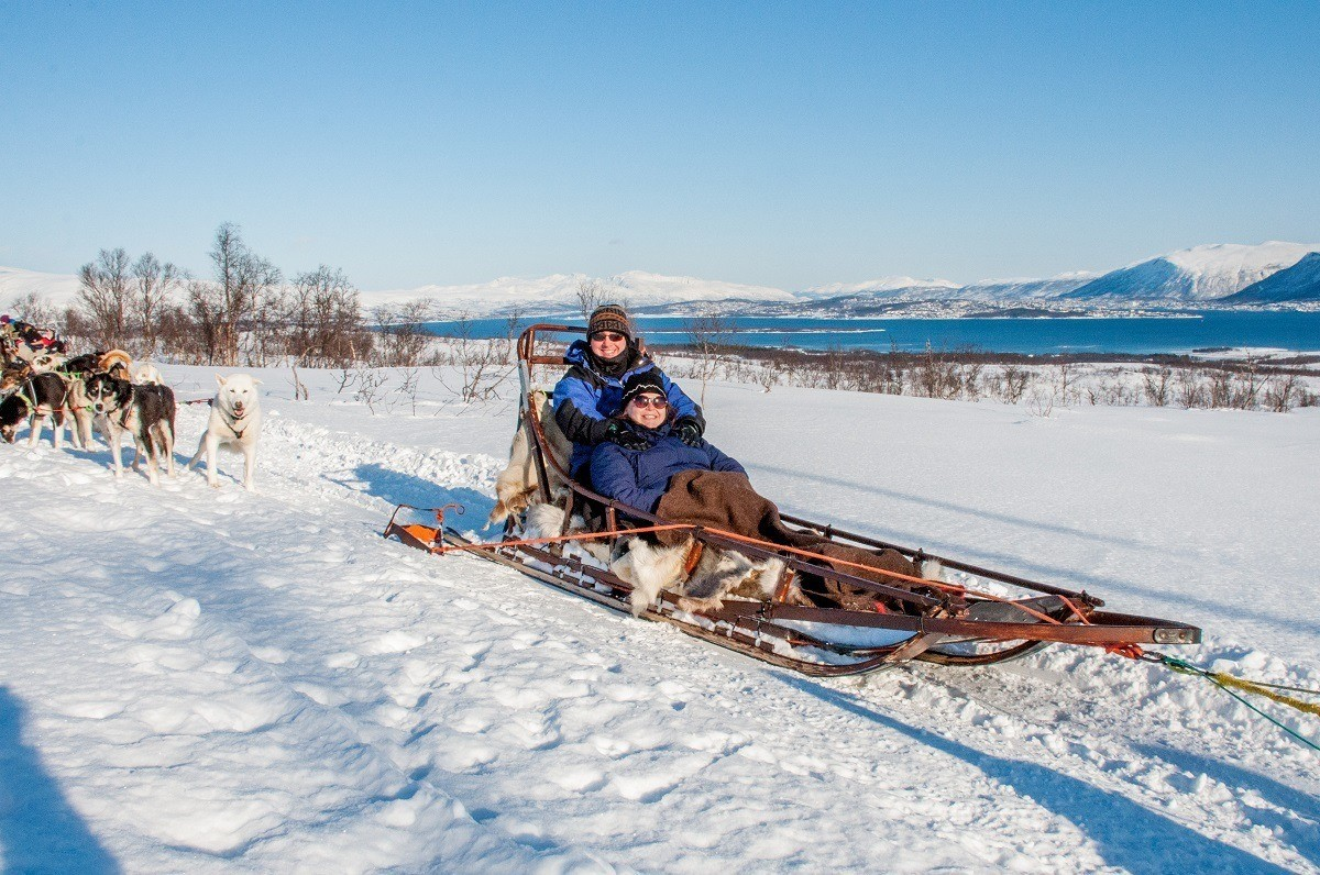 People in a dog sled in Tromso, Norway