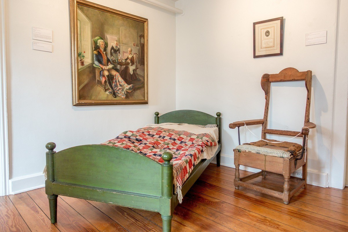Bed and chair on display at the Moravian Museum