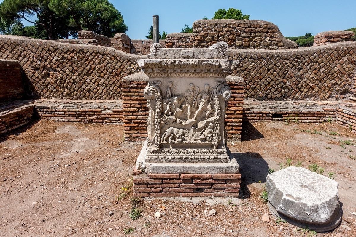 Pedestal with carved figures