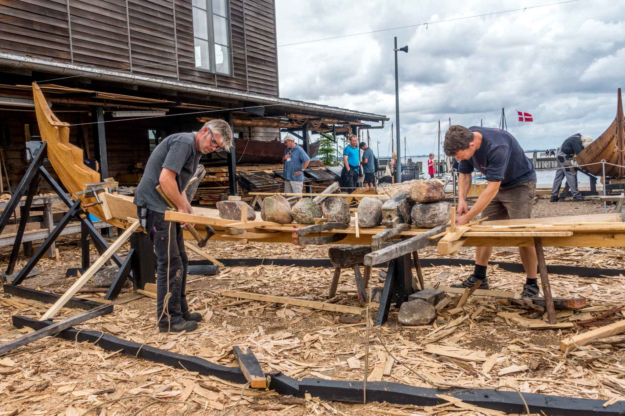 Expert builders building replica viking ships at the Viking Ship Museum in Roskilde, Denmark